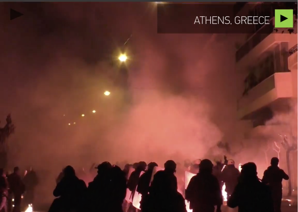 Greece a 'warzone' after teen killing protests turn violent