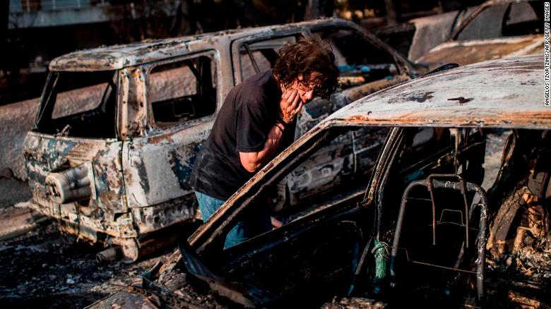 Cars turned to molten metal as Greek wildfires wipe villages off the