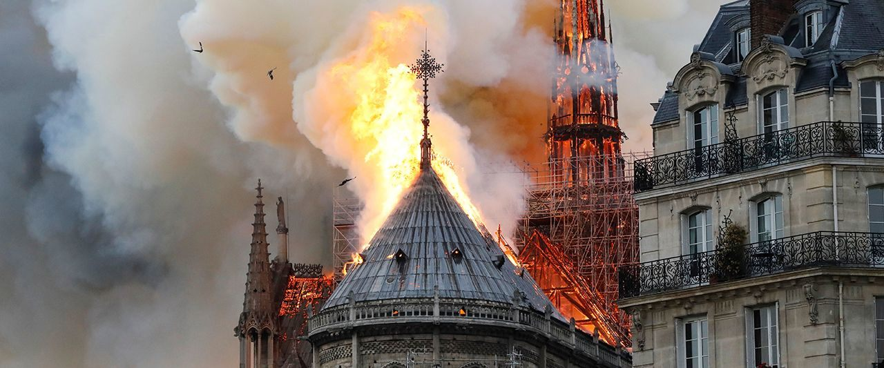 Central spire and roof of Paris' historic 12th-century cathedral collapse amid massive blaze. Massive fire breaks out in Notre Dame cathedral in Paris