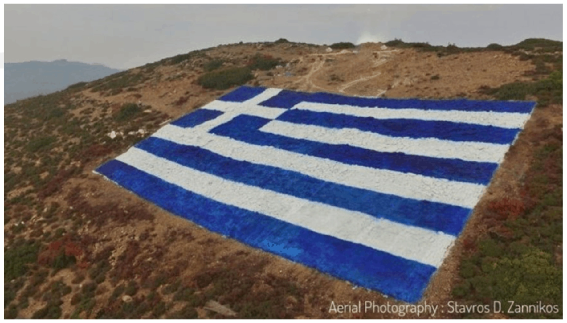 Greece's largest flag sends message to Turkish fighter jets violating Aegean air space