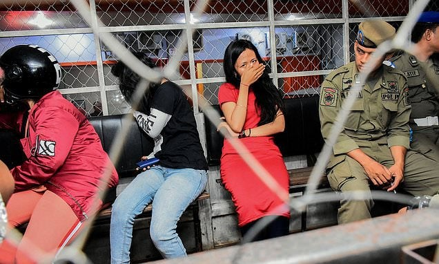 Valentine's Day ban sees dozens of unmarried couples arrested and crackdown on public displays of affection in Muslim-majority Indonesia