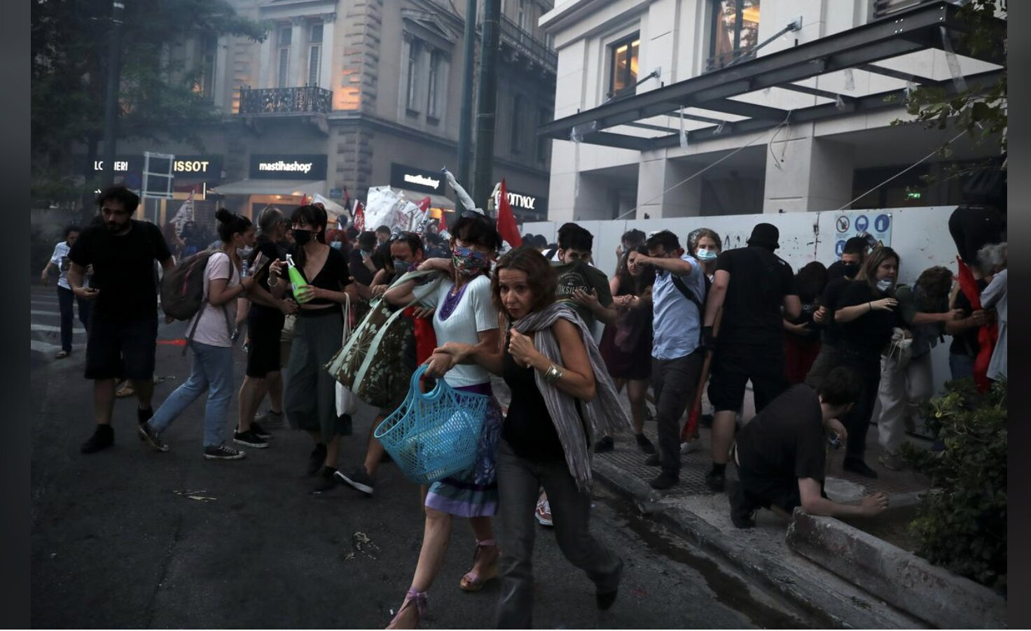 Greece passes law regulating demonstrations, thousands march in Athens