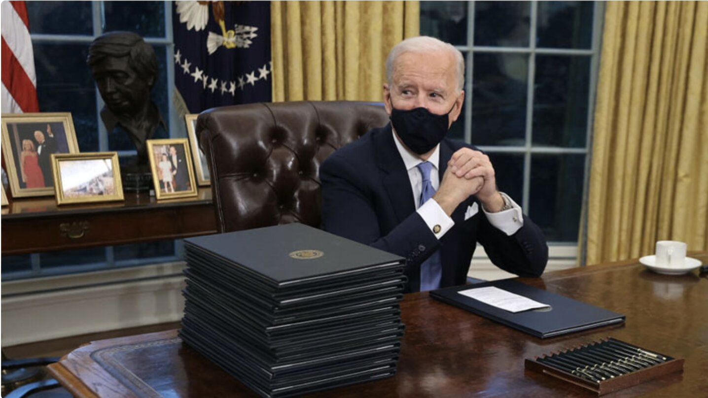 Biden Signs Flurry of Executive Orders, Starting With Mask Mandate, Paris Climate Agreement & Keystone XL Ban